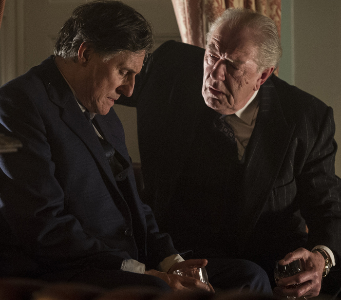 Gabriel Byrne as Quirke and Sir Michael Gambon as Judge Garrett Griffin